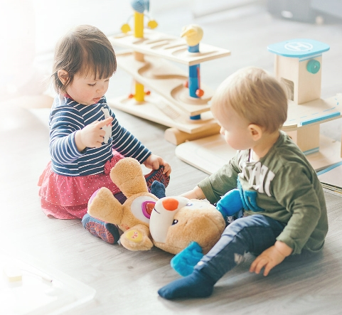 Todlers playing toys , (daycare)